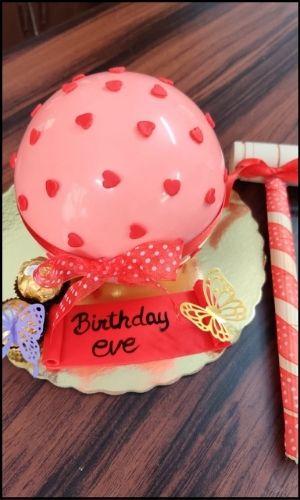 pink pinata cake with hammer